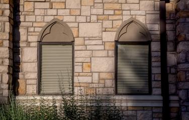 Stone wall interrupted by tabular windows, Our Lady of Mt. Carmel